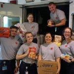 EMT students load ambulance